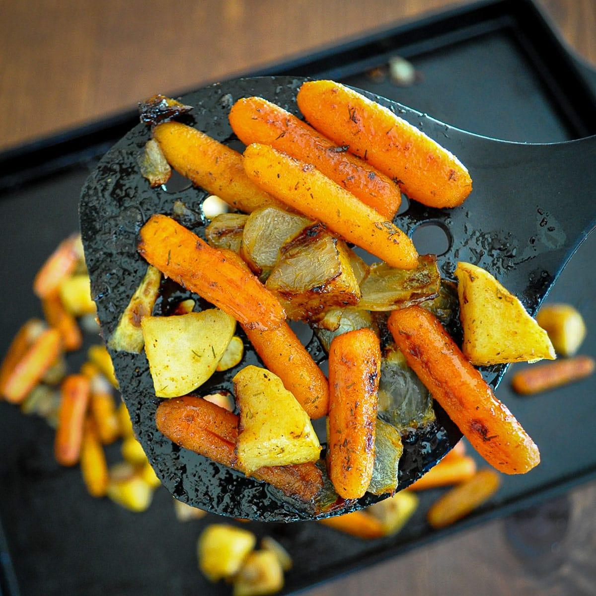roasted carrots on a spatula close up