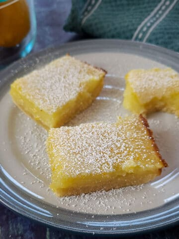 3 lemon bar cookies sitting on a plate