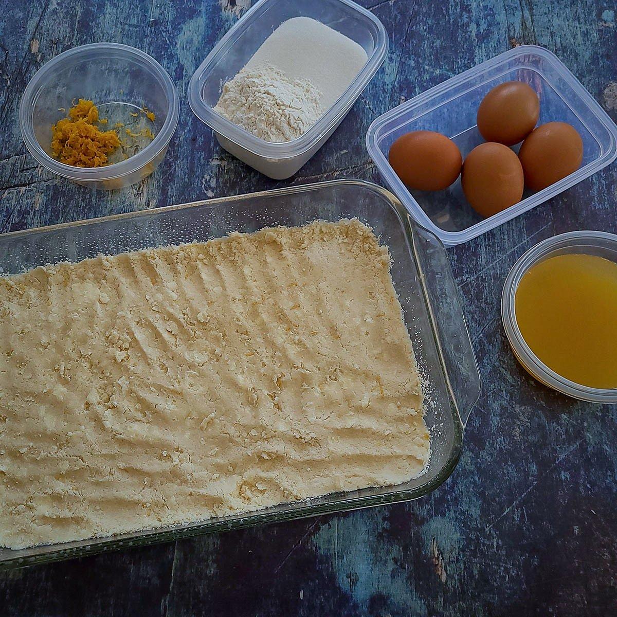 lemon bar cookie crust pressed into baking dish