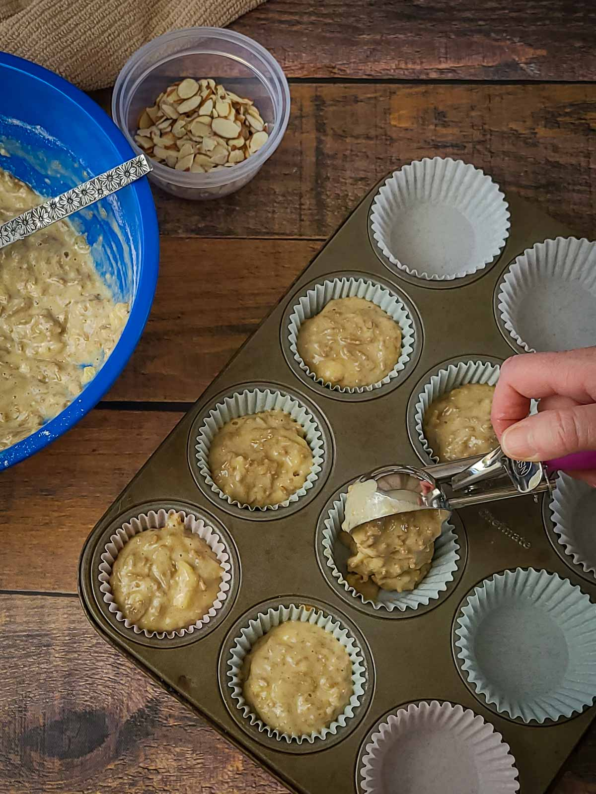 muffin batter being put in a muffin pan