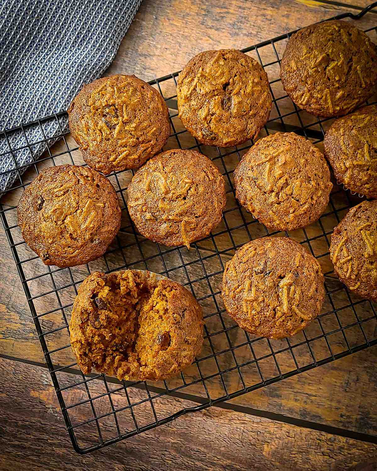 a rack of bran muffins with one split open