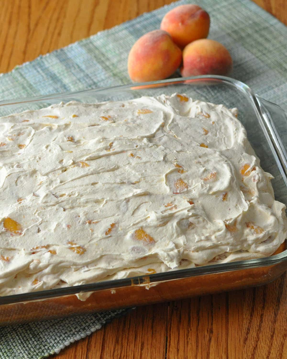 a peaches and cream cake in an oblong baking dish
