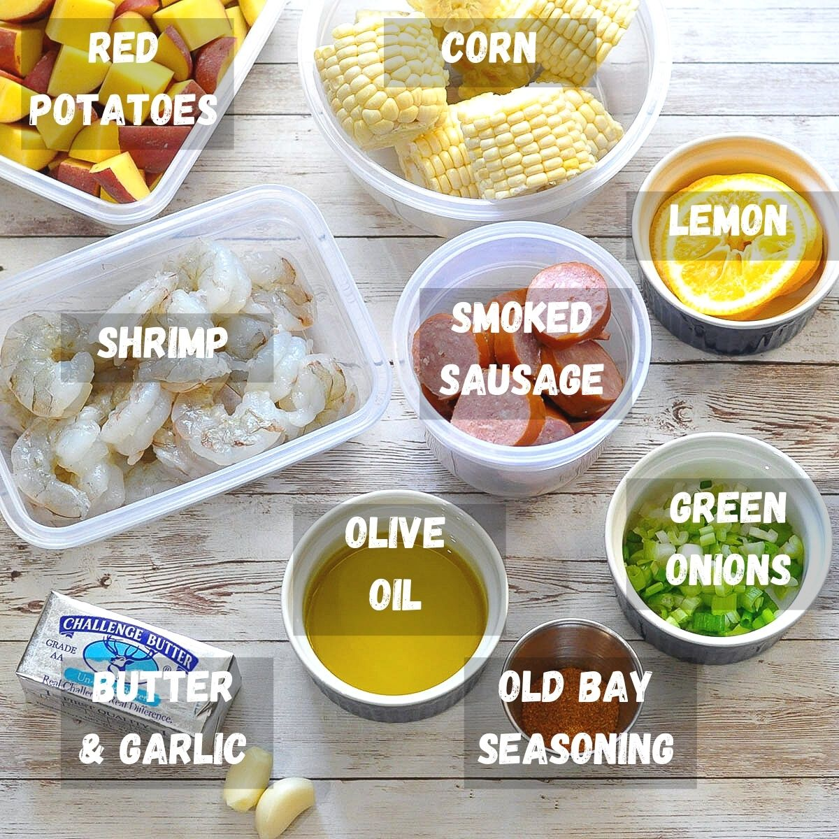 labeled ingredients laid out for shrimp boil packets