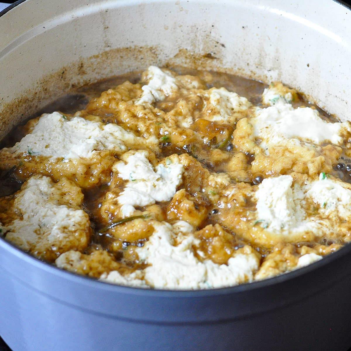 dumplings cooking in beef broth