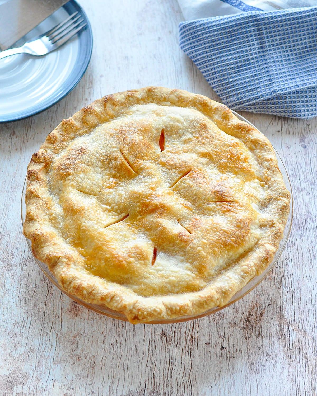 a freshly baked, double crust, peach pie